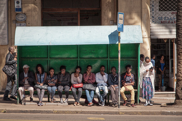 Commuters wait for a bus in Asmara, Eritrea. Photograph by Andrea Moroni.