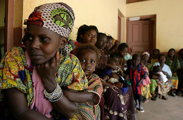 Waiting in line at a health centre in Bolemba, Central African Republic. Photograph by Pierre Holtz/UNICEF.