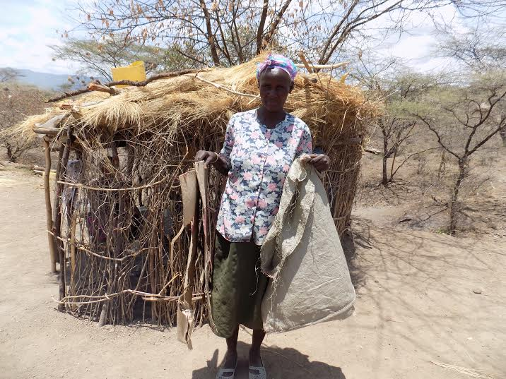 Margaret Deke outside her makeshift hut. Credit: Rachel Muthoni.