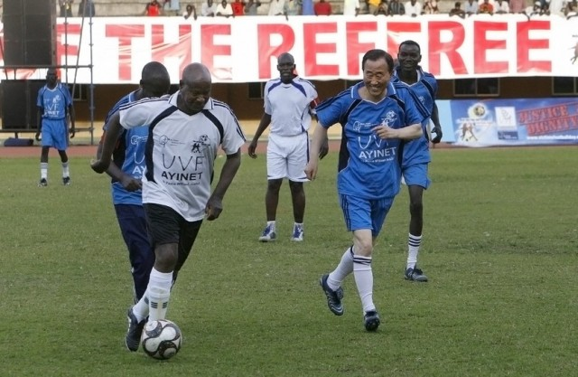President Yoweri Museveni plays a charity football match with UN Secretary-General Ban Ki Moon. Credit: UN Photo/Evan Schneider.