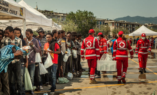 Red Cross welcomes migrants in Sicily, Italy.
