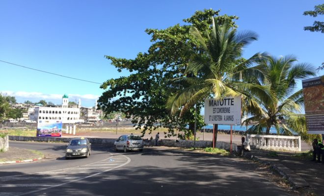 "A billboard in Moroni, Comoros' capital, reads: ""Mayotte is Comorian and will always be"". Credit: Ali Y. Alwahti."