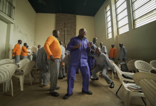 George dances with other inmates at the start of the Man Enough workshop.