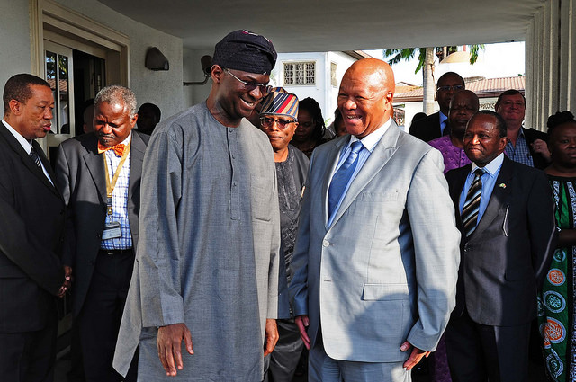 Babtunde Fashola (left) meets South African minister, Jeff Radebe (right). Photograph by GovernmentZA/DoC.