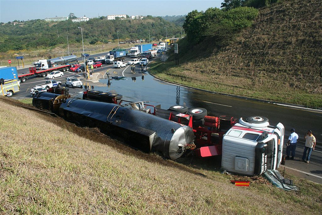 A tanker full of oil slips on a South African road. Credit: ER24 EMS (Pty) Ltd.