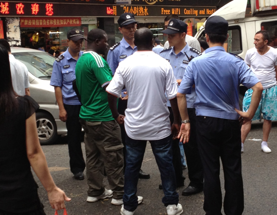 Immigration officials stop African traders in Guangzhou. Credit: Sam Piranty.