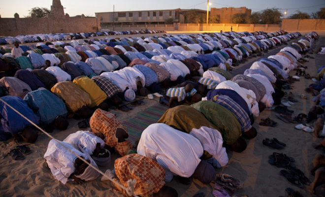Malians in the north pray outside in Timbuktu. Credit: United Nations Photo.
