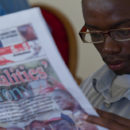 Reading a newspaper in Liberia. Credit: Together Liberia.
