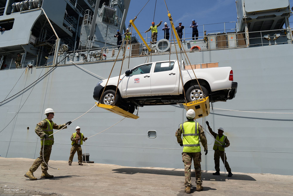 A UK Department for International Development (DfID) truck is unloaded in Freetown, Sierra Leone. Credit: Staff Sergeant Tom Robinson RLC.