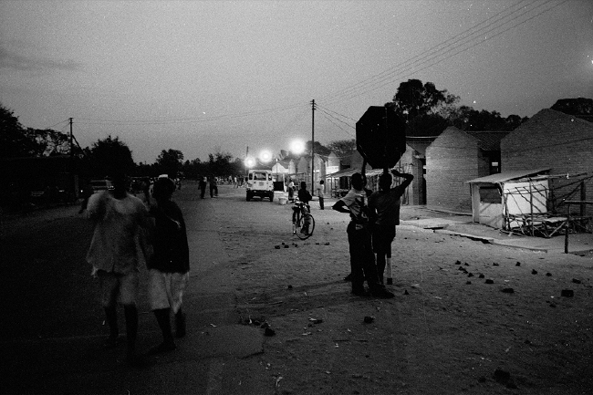 In some parts of Malawi, locals set up roadblocks and night-time patrols. Credit: stefano bandini.