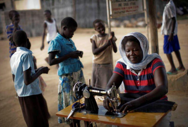 A female ex-combatant sews in South Sudan. Credit: UNDP South Sudan/Brian Sokol.