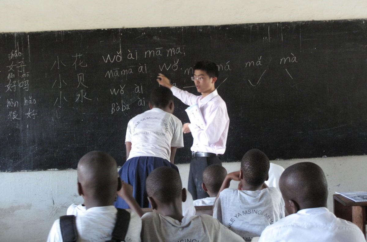 A Chinese teacher giving a lesson to young Tanzanian students. Credit: Claire van den Heever.