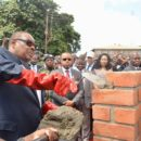 President Peter Mutharika lays a brick as Vice-President Saulos Chilima (in the sunglasses) watches on. Arthur Peter Mutharika