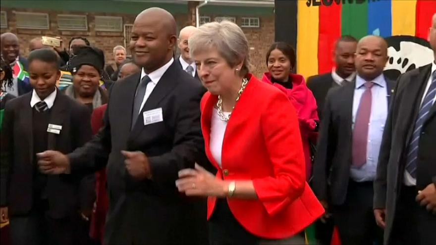 UK Prime Minister Theresa May dances in South Africa.