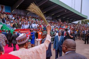 "President Muhammadu Buhari at a campaign rally brandishing a broom to ""sweep away corruption"". Credit: Muhammadu Buhari campaign."