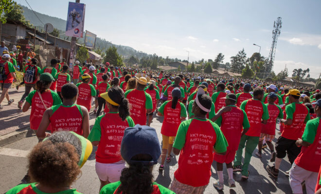 "Participants of the Great Ethiopian Run wear a t-shirt with the message ""Empower Women, Empower a Nation"" in Amharic on the back. Credit: UNICEF Ethiopia/2014/Sewunet."