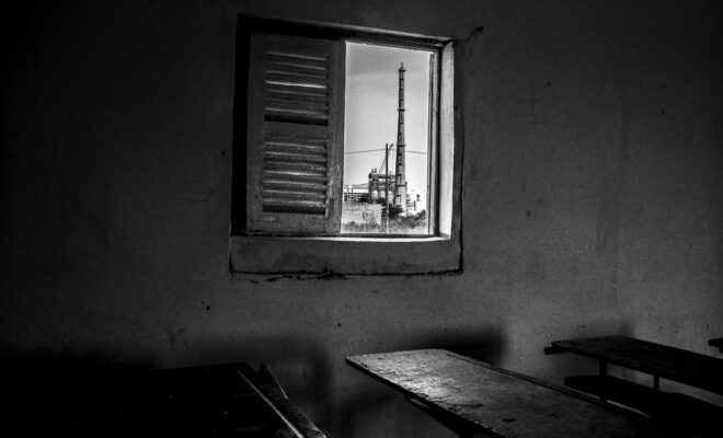 Senegal port. View from one of the classrooms of Miniam Primary School. It is located 388m from the coal-fired power plant that is soon in operation. According to teachers, there is still no plan to relocate the school. Credit: Pierre Vanneste.