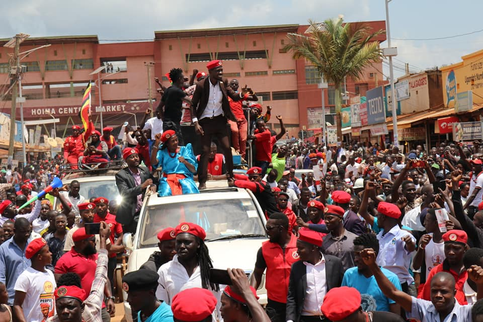 Bobi Wine and supporters at a rally this September don the red beret . Credit: Bobi Wine.