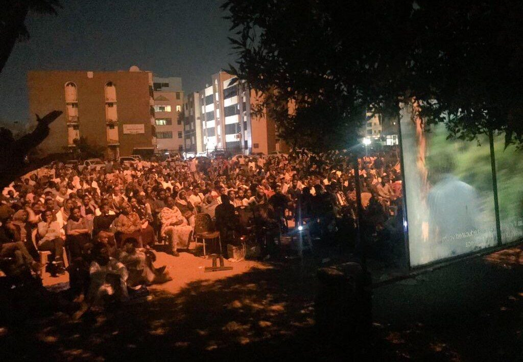 People gather for an open air film screening in Khartoum, Sudan.