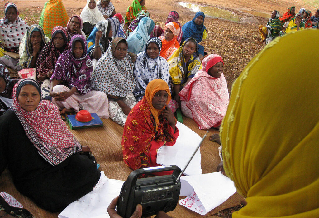 Women listen to a radio election broadcast in Zanzibar, Tanzania. Credit: UNDP.