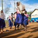 Girls education during coronavirus (COVID-19): Young girls play in the school yard in Kenya. Credit: GPE/Kelley Lynch.