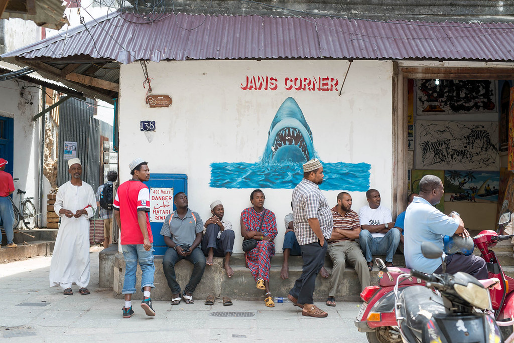 tanzania coronavirus covid-19: People gather on a corner in Stone Town, Zanzibar. Credit: Frans Peeters.