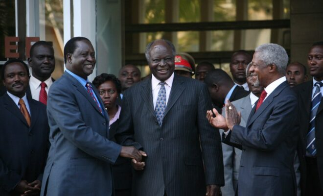 Mwai Kibaki shakes hands with opposition leader Raila Odinga during peace talks mediated by Kofi Annan in Kenya, January 2008. Credit: Boniface Mwangi/IRIN.