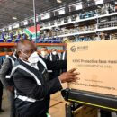President Cyril Ramaphosa receiving a consignment of Personal Protective Equipment (PPE) to deal with the COVID-19 pandemic. Credit: GCIS.