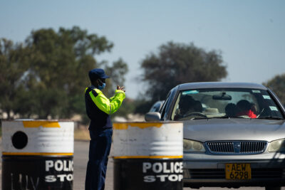 Zimbabwe doctor A police officer at a checkpoint in Bulawayo, Zimbabwe. Credit: KB Mpofu / ILO.