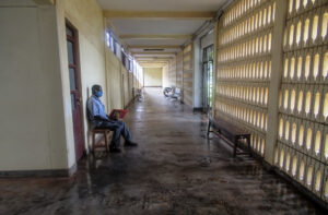 elections. A man waits in a hospital during the COVID-19 pandemic in Tanzania. Credit: Edith Macha.